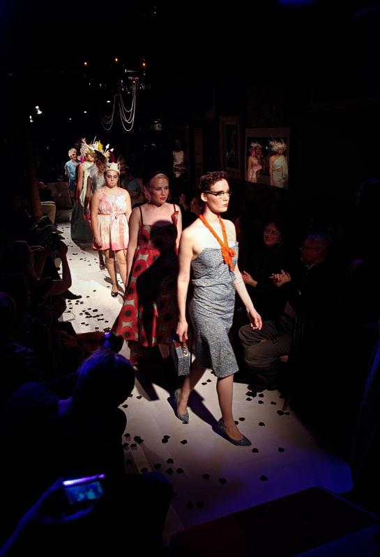 Models, including Mary Peden, of White River Junction, Vt., foreground, walk the runway at the conclusion of a fashion show held at the Main Street Museum in White River Junction, Vt., on April 4, 2015. The show featured the work of four local designers. (Valley News - Geoff Hansen) <p><i>Copyright © Valley News. May not be reprinted or used online without permission. Send requests to permission@vnews.com.</i></p> - Geoff Hansen | Valley News