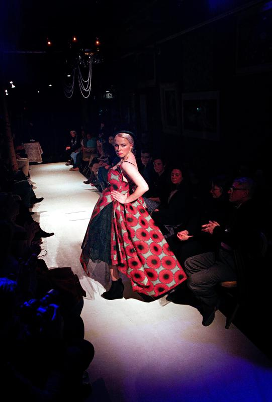 Model Caroline Collison, of Lebanon, N.H., shows a dress made by designer Rene Gerrior, of Lebanon, N.H., at a fashion show held at the Main Street Museum in White River Junction, Vt., on April 4, 2015. Gerrior uses the designer name Rene FrancesG. The show's 50 seats were sold out. (Valley News - Geoff Hansen) <p><i>Copyright © Valley News. May not be reprinted or used online without permission. Send requests to permission@vnews.com.</i></p> - Geoff Hansen | Valley News