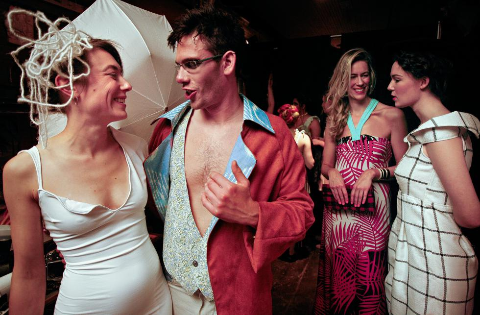 Bethany Fleishman, of Hartford, Vt., and Justin Barrett, of Vershire, Vt., talk backstage before the start of a fashion show held at the Main Street Museum in White River Junction, Vt., on April 4, 2015. Fleishman and Mary Peden, far right, of White River Junction, Vt., were showing the work of designer Rene Gerrior, of Lebanon, N.H., and Barrett for designer Mark E. Merrill of White River Junction, Vt. Second from right is designer Sigrid Lium, of White River Junction, Vt. Gerrior uses the designer name Rene FrancesG. (Valley News - Geoff Hansen) <p><i>Copyright © Valley News. May not be reprinted or used online without permission. Send requests to permission@vnews.com.</i></p> - Geoff Hansen | Valley News