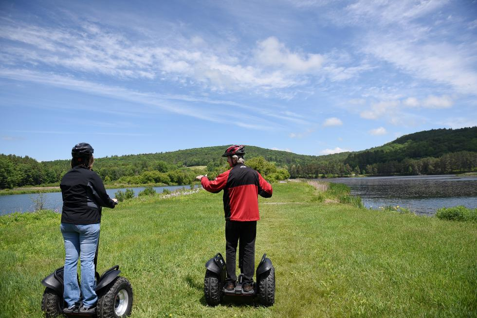 Gary Neil and Deborah Carbin look over one of the routes they have planned for Segway tours in Quechee, Vt., on June 6, 2015. (Valley News - Jennifer Hauck) <p><i>Copyright © Valley News. May not be reprinted or used online without permission. Send requests to permission@vnews.com.</i></p> - Jennifer Hauck | Valley News