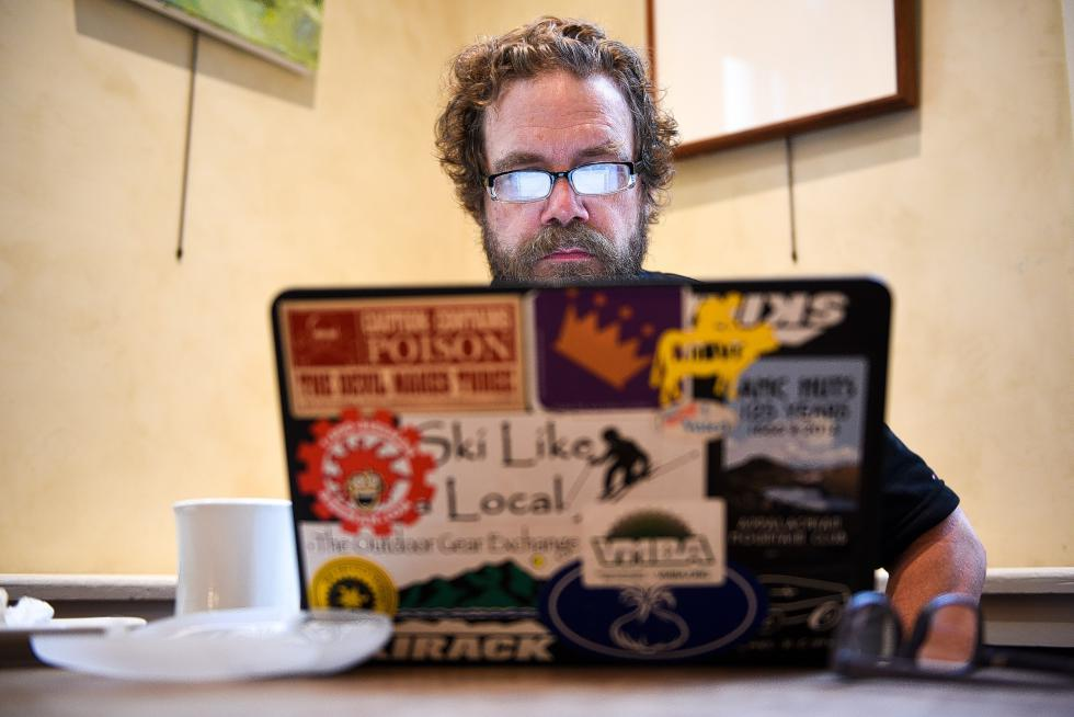 Dartmouth College computer science professor Sean Smith, 50, holds office hours at Umpleby's Cafe in Hanover, N.H. before heading to the college for a meeting Wednesday, July 15, 2015. Smith is research director of the Institute for Security, Technology and Society. (Valley News - James M. Patterson) Copyright © Valley News. May not be reprinted or used online without permission. Send requests to permission@vnews.com. - James M. Patterson | Valley News