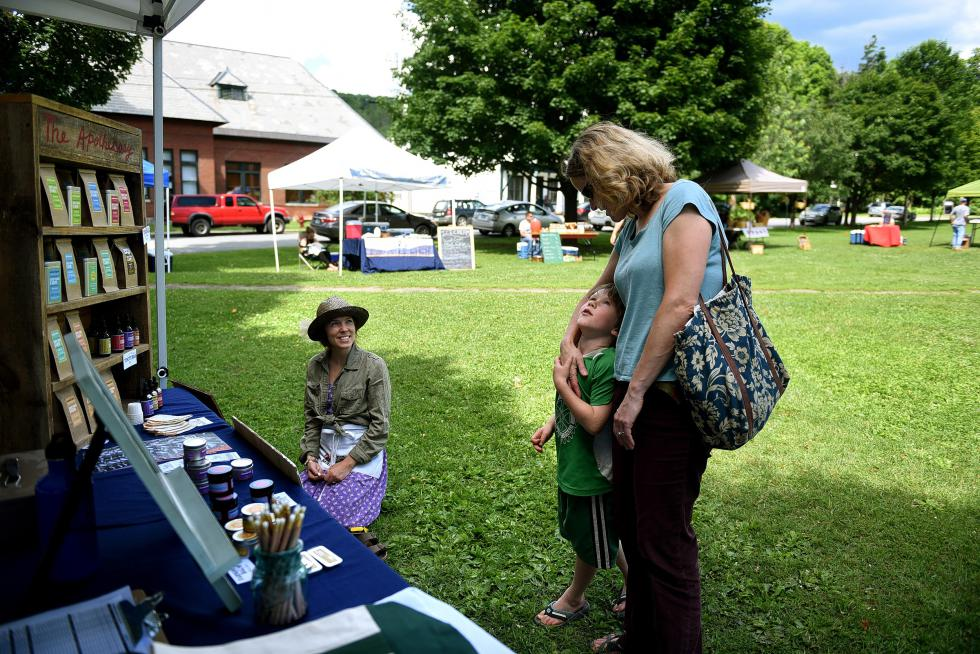 Taylor Katz of Free Verse Farm talks with Genevieve Faherty and her son Zane, 6, of East Orange, Vt., at the Chelsea Farmers Market, in Chelsea, Vt., on June 26, 2015. Katz and her husband, Misha Johnson, manage the market. (Valley News - Jennifer Hauck) <p><i>Copyright © Valley News. May not be reprinted or used online without permission. Send requests to permission@vnews.com.</i></p> - Jennifer Hauck | Valley News
