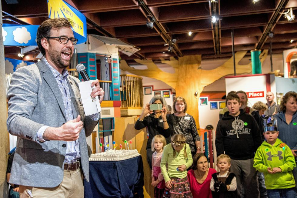 Executive Director Marcos Stafne leads everyone in  singing Happy Birthday during the Montshire Museum of Science's 40th anniversary celebration on Jan. 10. Nancy Nutile-McMenemy photograph  (www.photosbynanci.com) - Nancy Nutile-McMenemy |