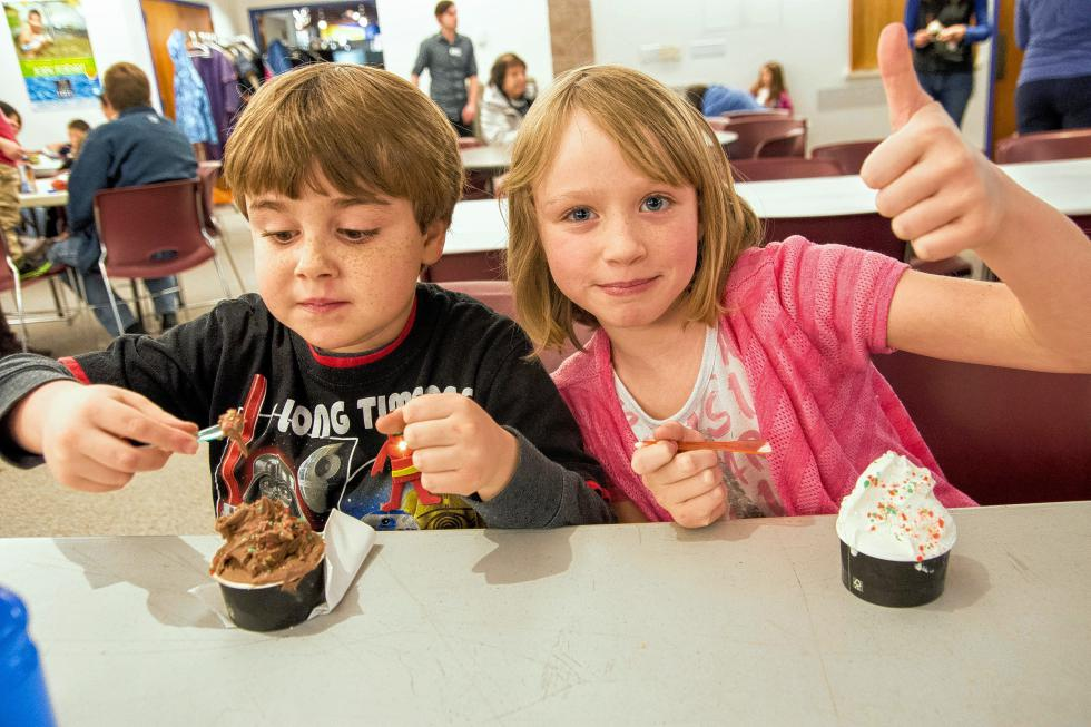 Cousins Griffin Stoudnour, 7, of Fairlee, and Isabel Shiers, 8, of Norway, Maine, compare the taste of Pop Rocks on different flavors of Morano Gelato during the Montshire Museum of Science's 40th anniversary celebration on Jan. 10. Nancy Nutile-McMenemy photograph  (www.photosbynanci.com) - Nancy Nutile-McMenemy |