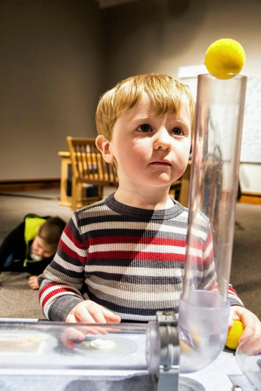 Malcolm Sharlet, 2, of Norwich, has fun with the air tubes while his dad, Jeff, takes pictures during the Montshire Museum of Science's 40th anniversary celebration on Jan. 10. Nancy Nutile-McMenemy photograph  (www.photosbynanci.com) - Nancy Nutile-McMenemy |