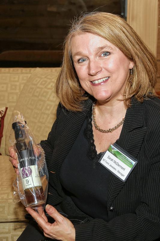 Woodstock Chamber member Sarah McDermet holds a gift from Simon Pearce to chamber members at the Chamber-to-Chamber mixer on Feb. 10 at Simon Pearce in Quechee, hosted by the Woodstock Area Chamber of Commerce and the Hartford Area Chamber of Commerce. (Gloria Towne photograph/allaroundtowne.com) - GLORIA TOWNE |