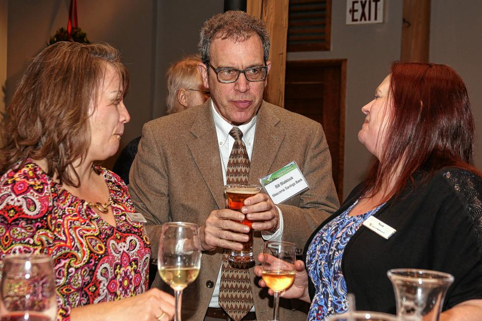 Andrea Brown, a teller with Lake Sunapee Bank, Bill Blaiklock, a branch manager at Mascoma Savings Bank, and Lake Sunapee Bank branch manager Nichole Dexter talk at the Chamber-to-Chamber mixer on Feb. 10 at Simon Pearce in Quechee, hosted by the Woodstock Area Chamber of Commerce and the Hartford Area Chamber of Commerce. (Gloria Towne photograph/allaroundtowne.com) - Gloria Towne |