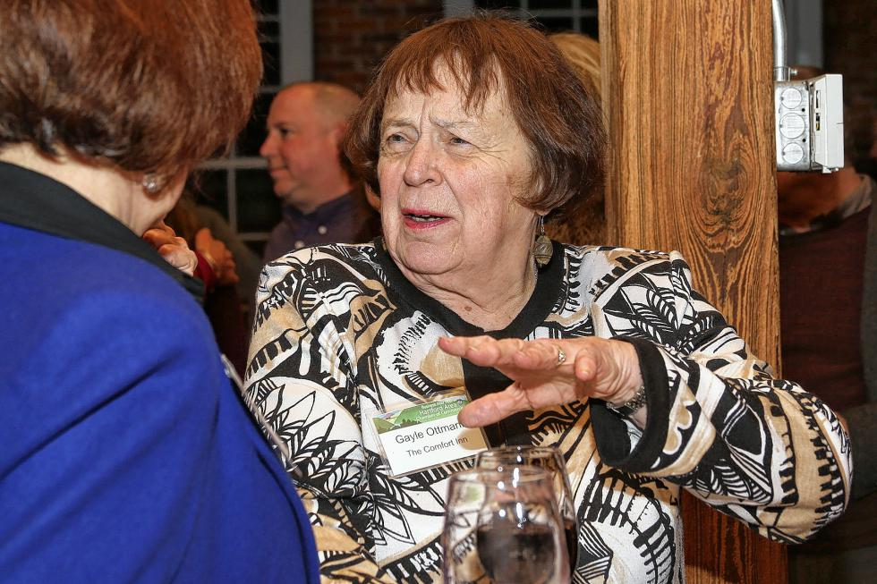 Gayle Ottmann speaks with Nancy Russel at the Chamber-to-Chamber mixer on Feb. 10 at Simon Pearce in Quechee, hosted by the Woodstock Area Chamber of Commerce and the Hartford Area Chamber of Commerce. (Gloria Towne photograph/allaroundtowne.com) - Gloria Towne |