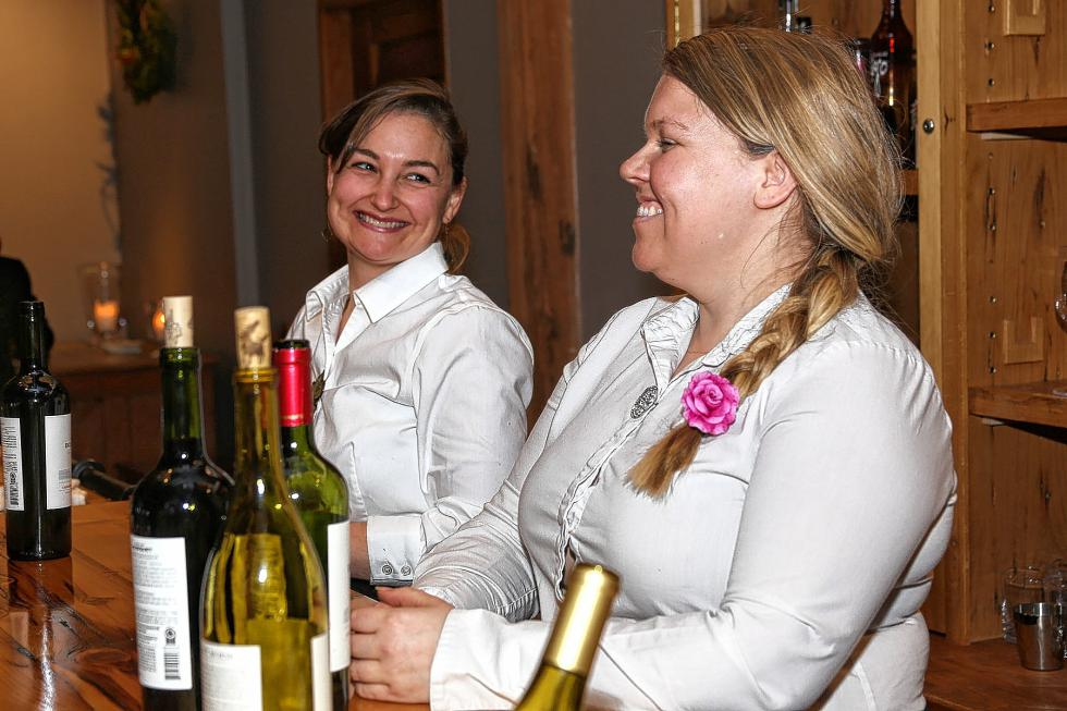 Rose Pfeiffer and Beth Pollari staffed the bar at the Chamber-to-Chamber mixer on Feb. 10 at Simon Pearce in Quechee, hosted by the Woodstock Area Chamber of Commerce and the Hartford Area Chamber of Commerce. (Gloria Towne photograph/allaroundtowne.com) - Gloria Towne |