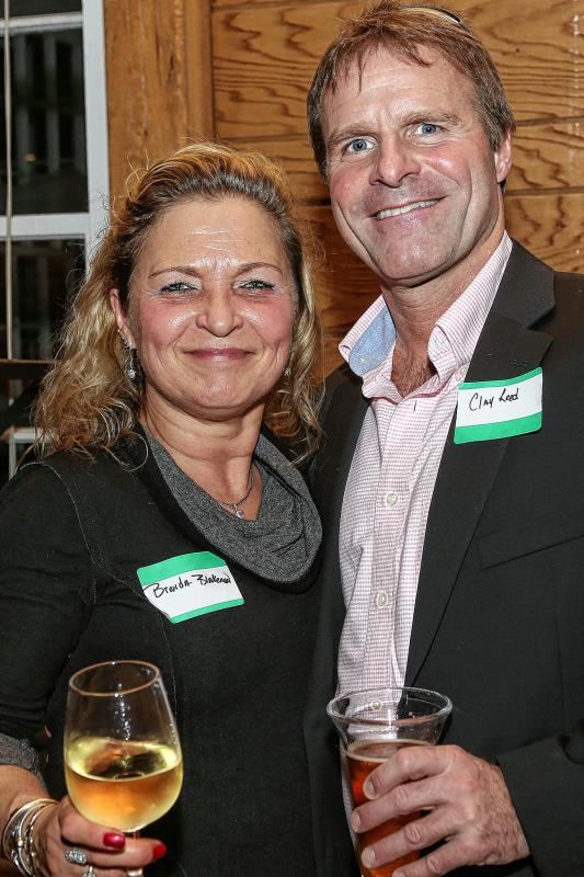 Brenda Blakeman, treasurer of the  Woodstock Chamber of Commerce, and Chamber member Clay Reed, at the Chamber-to-Chamber mixer on Feb. 10 at Simon Pearce in Quechee, hosted by the Woodstock Area Chamber of Commerce and the Hartford Area Chamber of Commerce. (Gloria Towne photograph/allaroundtowne.com) - Gloria Towne |