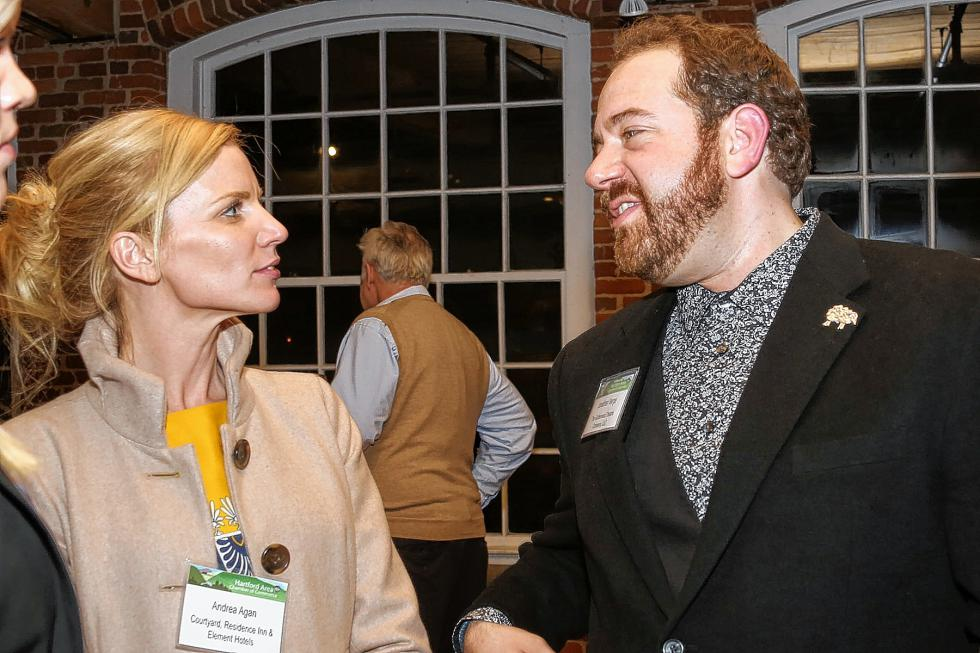 Jonathan Verge, of Gatherwoool Theatre Company, speaks with Andrea Agan of the Courtyard Residence Inn  at the Chamber-to-Chamber mixer on Feb. 10 at Simon Pearce in Quechee, hosted by the Woodstock Area Chamber of Commerce and the Hartford Area Chamber of Commerce. Verge offered 16 theater tickets as a raffle prize. (Gloria Towne photograph/allaroundtowne.com) - Gloria Towne |