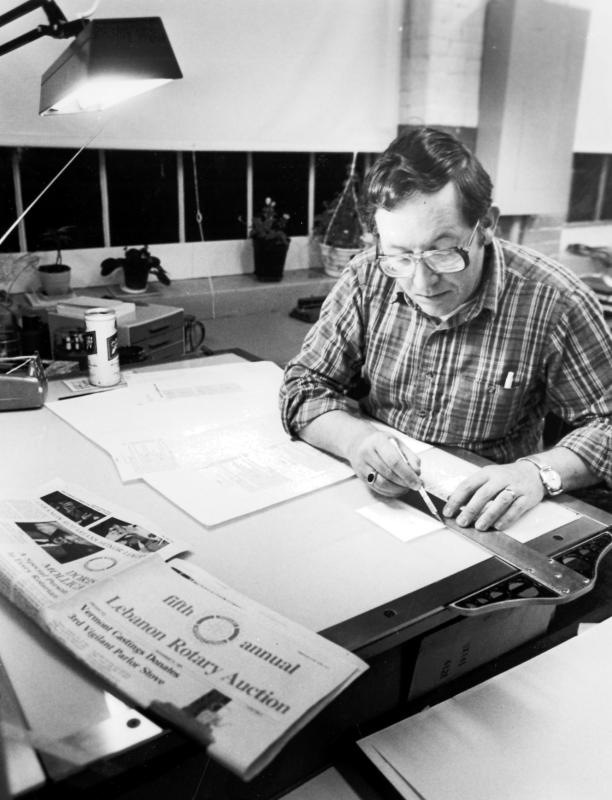 Paul Boucher works on the Lebanon Rotary Club's annual auction guide at Whitman Press in a photograph from 1982. (Valley News photograph) -