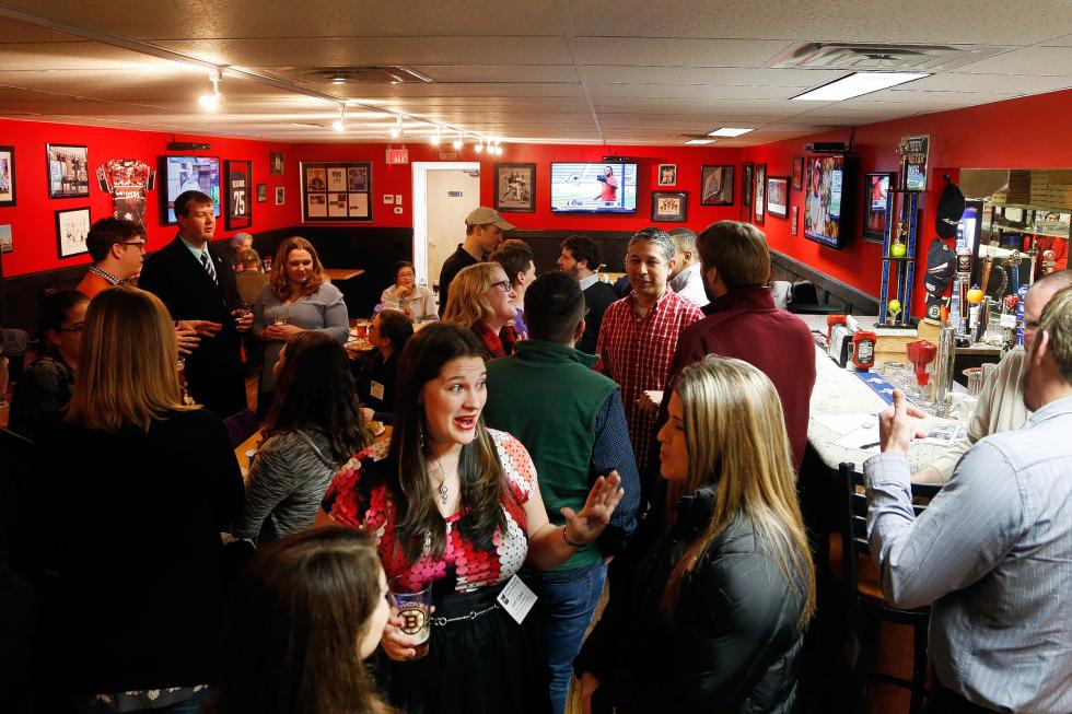 Twenty, thirty, and forty-somethings mingle at Cantore's Pizza in West Lebanon, N.H., on Feb. 16, 2016, during a mixer for the Upper Valley Young Professionals. (Valley News- Sarah Priestap) <p><i>Copyright © Valley News. May not be reprinted or used online without permission. Send requests to permission@vnews.com.</i></p> - Sarah Priestap |