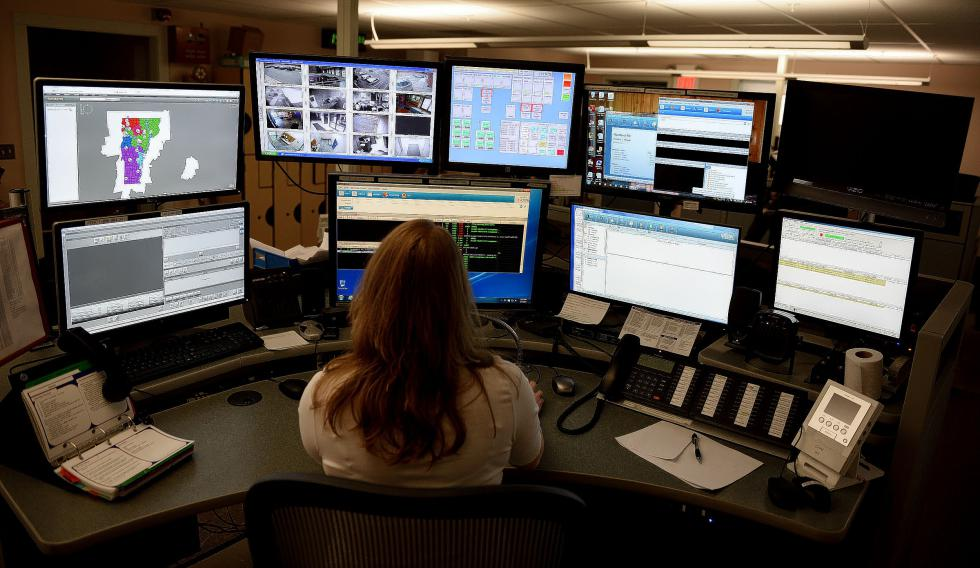 Dispatcher Martha Morse works during her shift at Hartford dispatch in Hartford, Vt., on March, 4, 2016.  (Valley News - Jennifer Hauck) <p><i>Copyright © Valley News. May not be reprinted or used online without permission. Send requests to permission@vnews.com.</i></p> - Jennifer Hauck | Valley News