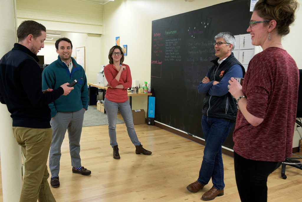 From left, Tom Scully, Tyler Dewdney, Allie Moehrke, and Alison Bowen, right, talks with Appcast CEO Chris Forman, at the Lebanon, N.H. based tech company Thursday October 27, 2016. (Valley News - James M. Patterson) Copyright Valley News. May not be reprinted or used online without permission. Send requests to permission@vnews.com.