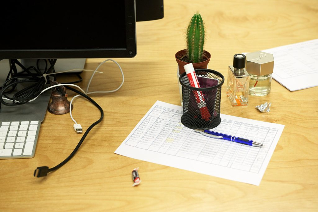 A cactus, a tootsie roll, perfume, a miniature of the Liberty Bell, sit at a work space in the Appcast office in the Whitman Communications Building in Lebanon, N.H., Thursday October 27, 2016. (Valley News - James M. Patterson) Copyright Valley News. May not be reprinted or used online without permission. Send requests to permission@vnews.com.