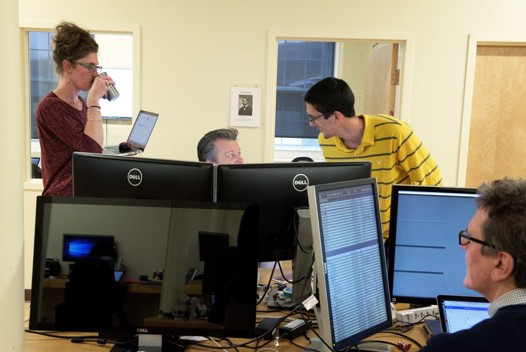 Product manager Josh Goodrich, back right, and account manager Alison Bowen, left, works with Vice President of Customer Success Mark Amdahl, middle, at Appcast in Lebanon, N.H., Thursday, October 27, 2016. Chief Scientist Mark Florence is at foreground right. (Valley News - James M. Patterson) Copyright Valley News. May not be reprinted or used online without permission. Send requests to permission@vnews.com.