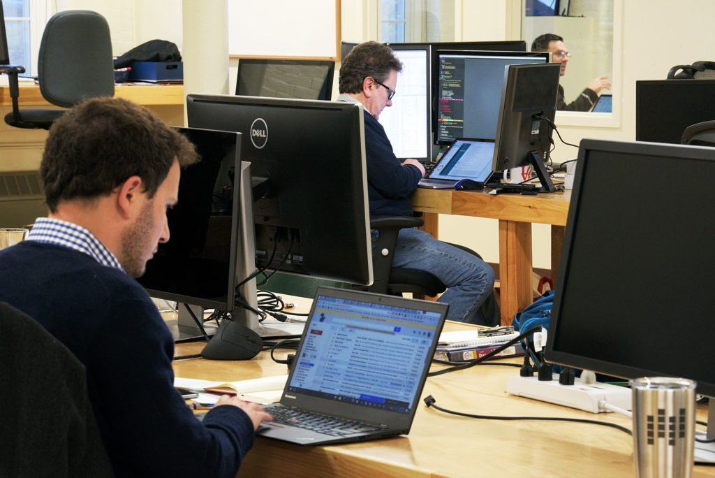 Jon Silber, an Appcast partner, left, Chief Scientist Mark Florence, middle, and Vice President of Publisher and Network Operations Brian Garfield, right, work in the offices of Appcast in Lebanon, N.H. Thursday, October 27, 2016. The start-up serves as a digital medium between large employers and publishers of job ads. (Valley News - James M. Patterson) Copyright Valley News. May not be reprinted or used online without permission. Send requests to permission@vnews.com.