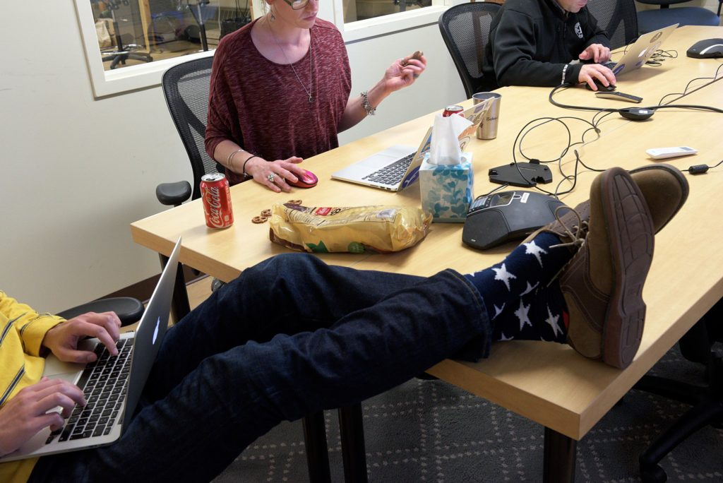 Product manager, Josh Goodrich, left, kicks up his feet while working with account manager Alison Bowen, middle, and manager of publisher operations Brian Garfield, right, at Appcast in Lebanon, N.H., Thursday, October 27, 2016. Appcast serves as a digital medium between large employers and publishers of job ads, Thursday October 27, 2016. (Valley News - James M. Patterson) Copyright Valley News. May not be reprinted or used online without permission. Send requests to permission@vnews.com.