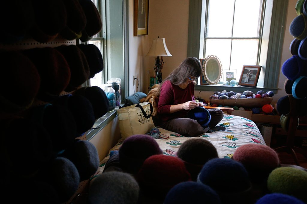 : HAT HANDIWORK Carrie Cahill Mulligan embroiders a hand-knit hat in her home studio. She started making the hats in 2000, while she was living in Alaska.