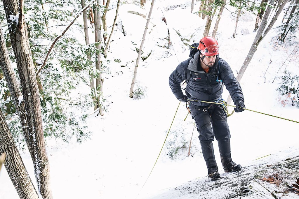 Dave Keaveny, of Canaan, N.H., a medical specialist and advanced EMT with Global Rescue, repels down to a wounded climber below during a training exercise in Lebanon, N.H., on Friday, December 9, 2016. Keaveny comes from a background in ski patrol, ambulance services, and wilderness search and rescue. (Valley News - John Happel) Copyright Valley News. May not be reprinted or used online without permission. Send requests to permission@vnews.com.