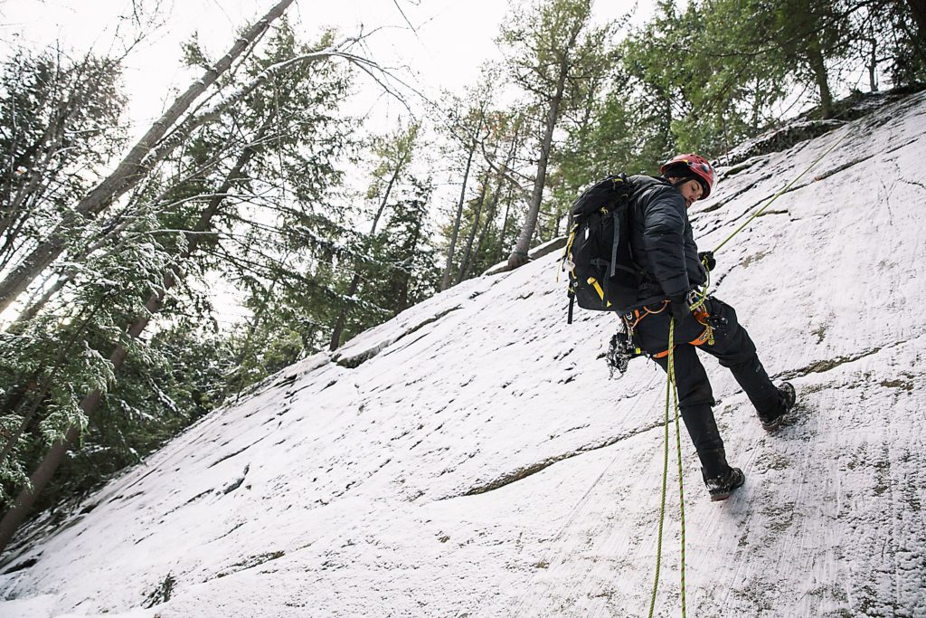 Dave Keaveny, of Canaan, N.H., a medical specialist and advanced EMT with Global Rescue, practices rappelling down an icy cliff face during a training exercise for Global Rescue in Lebanon, N.H., on Friday, December 9, 2016. (Valley News - John Happel) Copyright Valley News. May not be reprinted or used online without permission. Send requests to permission@vnews.com.