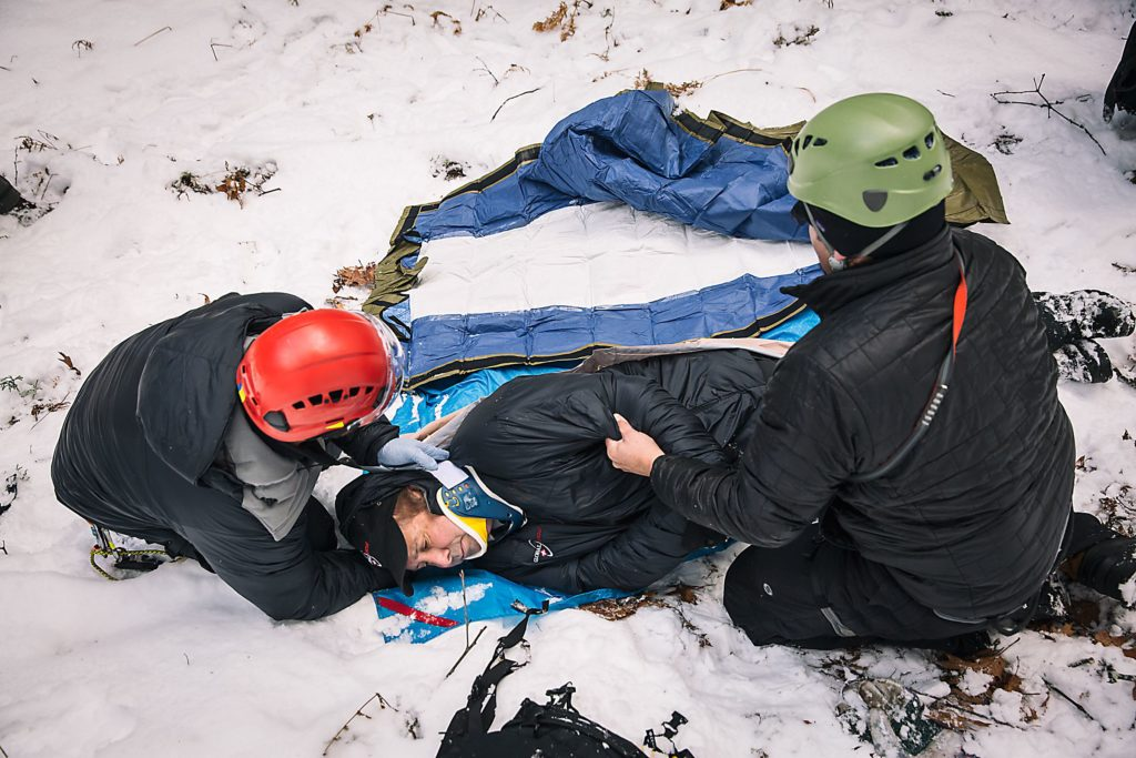 Dave Keaveny. left, of Canaan, N.H., and Mark Zamora, right, of Etna, N.H., provide medical aid to wounded climber, Wally Wing, of Lebanon, N.H., during a training exercise in Lebanon, on Friday, December 9, 2016. One of the services offered by Global Rescue is casualty evacuation from remote environments. (Valley News - John Happel) Copyright Valley News. May not be reprinted or used online without permission. Send requests to permission@vnews.com.