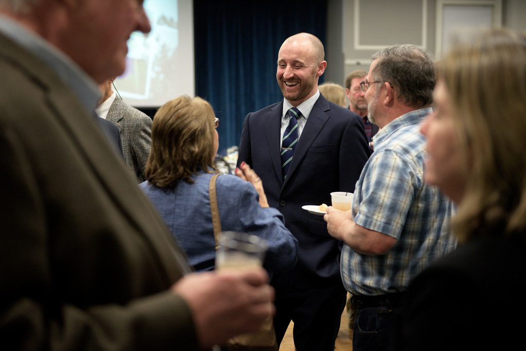 Dan O'Halloran, of North Sutton, N.H., outgoing president of the Lake Sunapee Region Chamber of Commerce, socializes before the organization's annual meeting at Colby-Sawyer College in New London, N.H., on Tuesday, January 18, 2017. During the meeting, O'Halloran handed over the office to Rich Marshall, of New London. (Valley News - James M. Patterson) Copyright Valley News. May not be reprinted or used online without permission. Send requests to permission@vnews.com.