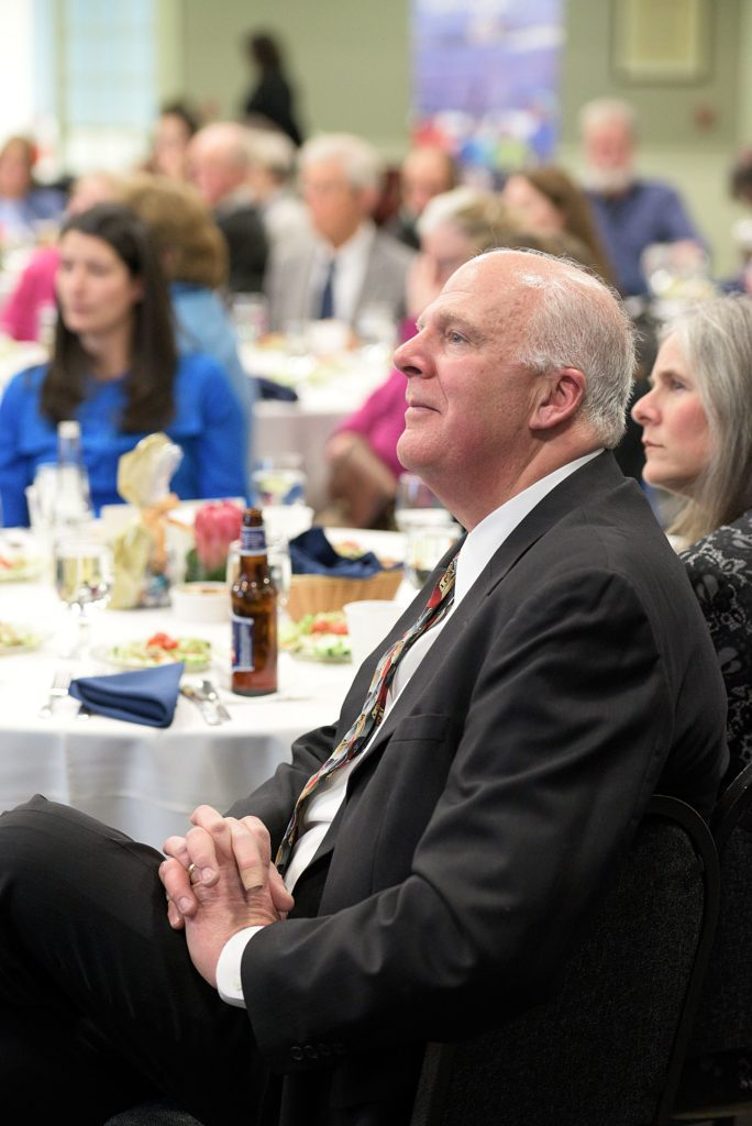 Rich Marshall, of New London, listens to the annual report of Lake Sunapee Region Chamber of Commerce Dan O'Halloran during the Chamber's annual meeting at Colby-Sawyer College in New London, N.H., Tuesday, January 17, 2017. After two years as vice president, Marshall took over the presidency from O'Halloran Wednesday night. (Valley News - James M. Patterson) Copyright Valley News. May not be reprinted or used online without permission. Send requests to permission@vnews.com.