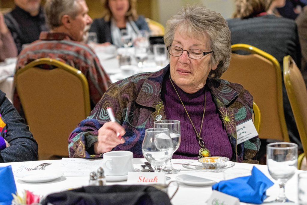 Cohase Chamber of Commerece member Nancy P. Jones, of the Bradford, Vt., Conservation Commission, looks over her answers to the trivia game during the chamber's annual meeting, held Jan. 23 at the Lake Morey Resort in Fairlee. (Nancy Nutile-McMenemy photograph, www.photosbynanci.com)