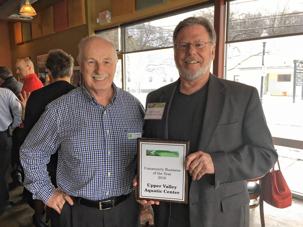 Rich Synnott, right, executive director of the Upper Valley Aquatic Center, accepted the Community Business of the Year award from P.J. Skehan of the Hartford Area Chamber of Commerce. (Courtesy photograph)
