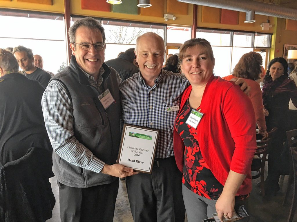 : AWARD WINNERS  Bill Blaiklock, left, and Crystal Rogers, right, of Dead River Co., accept the Community Business of the Year award from P.J. Skehan of the Hartford Area Chamber of Commerce.