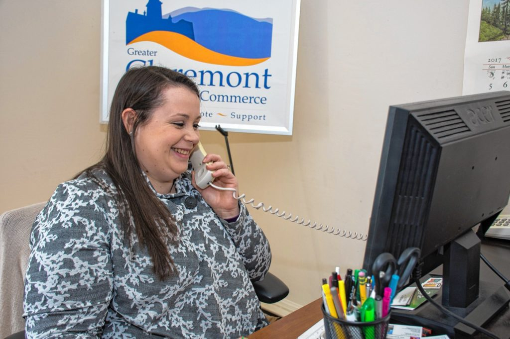 Elyse Crossman on the phone. The Greater Claremont Chamber of Commerce  has 150 members. Nancy Nutile-McMenemy photograph