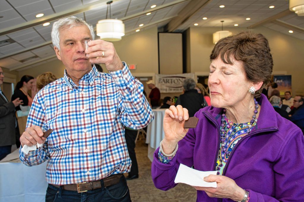 Milton and Rhonda Weinstein of Eastman and Boston enjoy the paired wine and chocolates at the Lindt table. Nancy Nutile-McMenemy photograph
