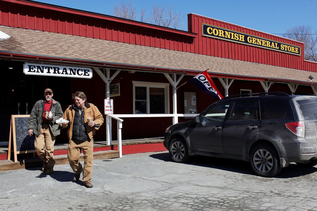 : OPEN FOR BUSINESSAfter buying lunch, electricians Rob Richardson, left, of Gilmanton, N.H., and Andy Sanborn, of Sanbornton, N.H., leave the newly reopened Cornish General Store.