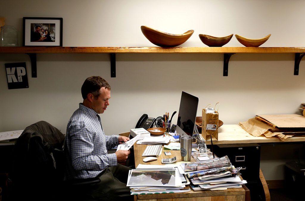 Andrew Pearce works in the office at his manufacturing facility and showroom in Hartland, Vt., on April 12, 2017. Pearce started the business in 2014 in Bethel, Vt. The company made 8,500 bowls last year. (Valley News - Geoff Hansen) Copyright Valley News. May not be reprinted or used online without permission. Send requests to permission@vnews.com.