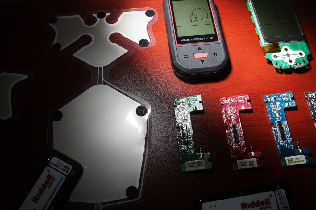 Versions of Simbex's Head Impact Telemetry System (HITS), on Thursday, April 13, 2017, in Lebanon, N.H. The HITS technology consists of film-thin microchip sensors placed on the inside of football helmets that measure the force of impacts to the head and relay the information to receiving equipment and computers where the data is studied by doctors to assess the extent of the injury. (Valley News - Jovelle Tamayo) Copyright Valley News. May not be reprinted or used online without permission. Send requests to permission@vnews.com.