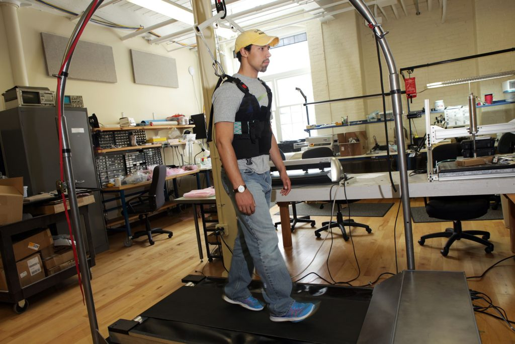 Alexander Hastings, an intern at Simbex, demonstrates Simbex ActiveStep technology on Thursday, April 13, 2017, in Lebanon, N.H. The physical rehabilitation treadmill, ActiveStep, is computer-controlled and outfitted with a harness to help patients who've suffered from slips relearn how to gain their balance. (Valley News - Jovelle Tamayo) Copyright Valley News. May not be reprinted or used online without permission. Send requests to permission@vnews.com.