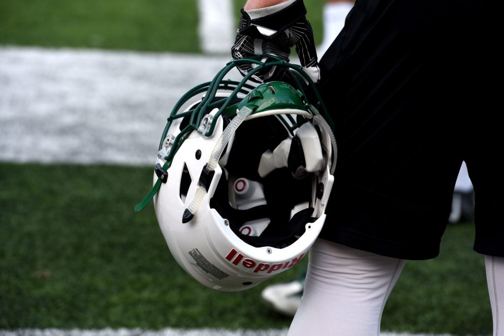 A Dartmouth football player watches from the sideline during a practice in Hanover, N.H, on April 28, 2017. This particular helmet has sensors in it.(Valley News - Jennifer Hauck) Copyright Valley News. May not be reprinted or used online without permission. Send requests to permission@vnews.com.