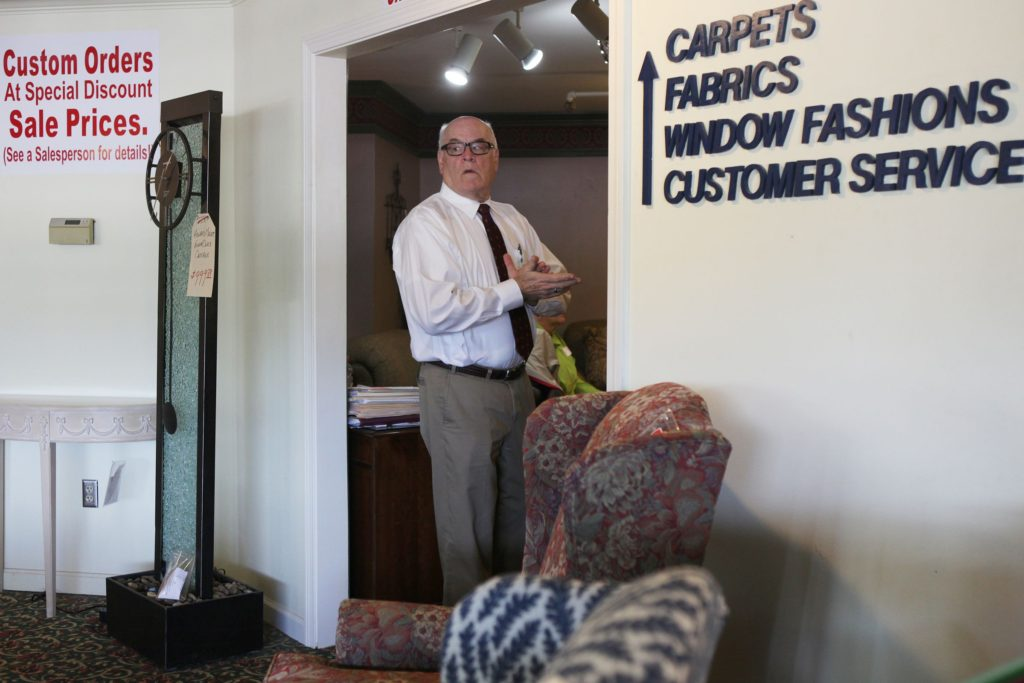 Dan Rutledge checks the main showroom at Bridgman's Furniture on Friday, May 12, 2017, in Lebanon, N.H. Bridgman's Furniture owner Steve Rutledge is retiring and selling his stake to his brother Dan, who will take over day-to-day operations. (Valley News - Jovelle Tamayo) Copyright Valley News. May not be reprinted or used online without permission. Send requests to permission@vnews.com.