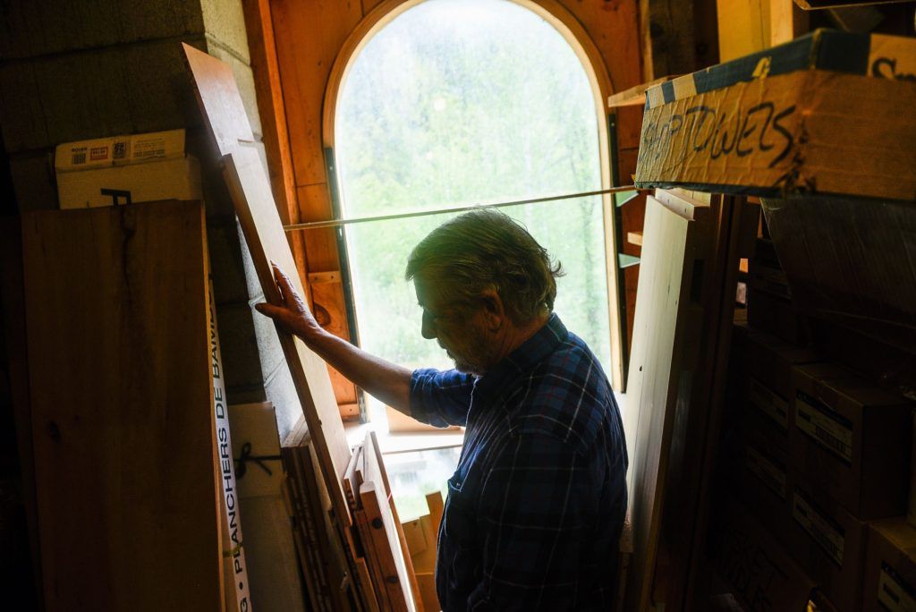 Michael Whitman, a volunteer educator with the nonprofit Funeral Consumers Alliance, at his Lyme, N.H. woodworking shop on Sunday, May 21, 2017. Whitman crafts a few simple wooden caskets annually. (Valley News - Jovelle Tamayo) Copyright Valley News. May not be reprinted or used online without permission. Send requests to permission@vnews.com.