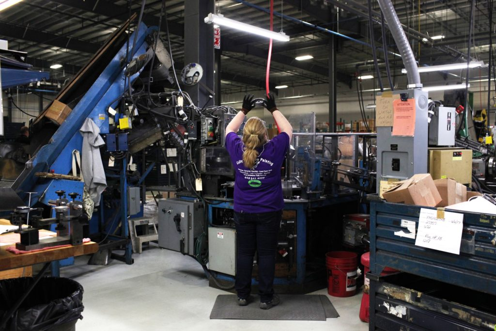 Kim Borcuk, of Claremont, N.H., inspects a pulley part at New Hampshire Industries, also known as NHI, on Tuesday, June 6, 2017, in Claremont. NHI, a pulley manufacturer, recently consolidated its operations from Lebanon, N.H. and Wisconsin to a 137,000-square-foot building in Claremont. (Valley News - Jovelle Tamayo) Copyright Valley News. May not be reprinted or used online without permission. Send requests to permission@vnews.com.