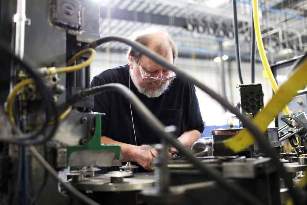 Machinist Joel Tremblay, of Lebanon, N.H., processes pulley parts at New Hampshire Industries, also known as NHI, on Tuesday, June 6, 2017, in Claremont, N.H. NHI, a pulley manufacturer, recently consolidated its operations from Lebanon and Wisconsin to a 137,000-square-foot building in Claremont. (Valley News - Jovelle Tamayo) Copyright Valley News. May not be reprinted or used online without permission. Send requests to permission@vnews.com.
