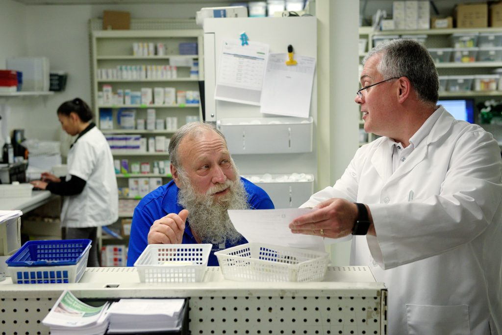 Pharmacists Randy Doerr, left, and Glenn Perreault, right, are building a new home for their Colonial Pharmacy in New London, N.H., after 30 years in their current location. The new pharmacy will be less than a mile away and have a specially equipped room for compouding, allowing them to continue preparing medicines that are not commercially available, or are specific to an individual patient's needs. Doerr and Perreault discuss a prescription Friday, June 16, 2017. (Valley News - James M. Patterson) Copyright Valley News. May not be reprinted or used online without permission. Send requests to permission@vnews.com.