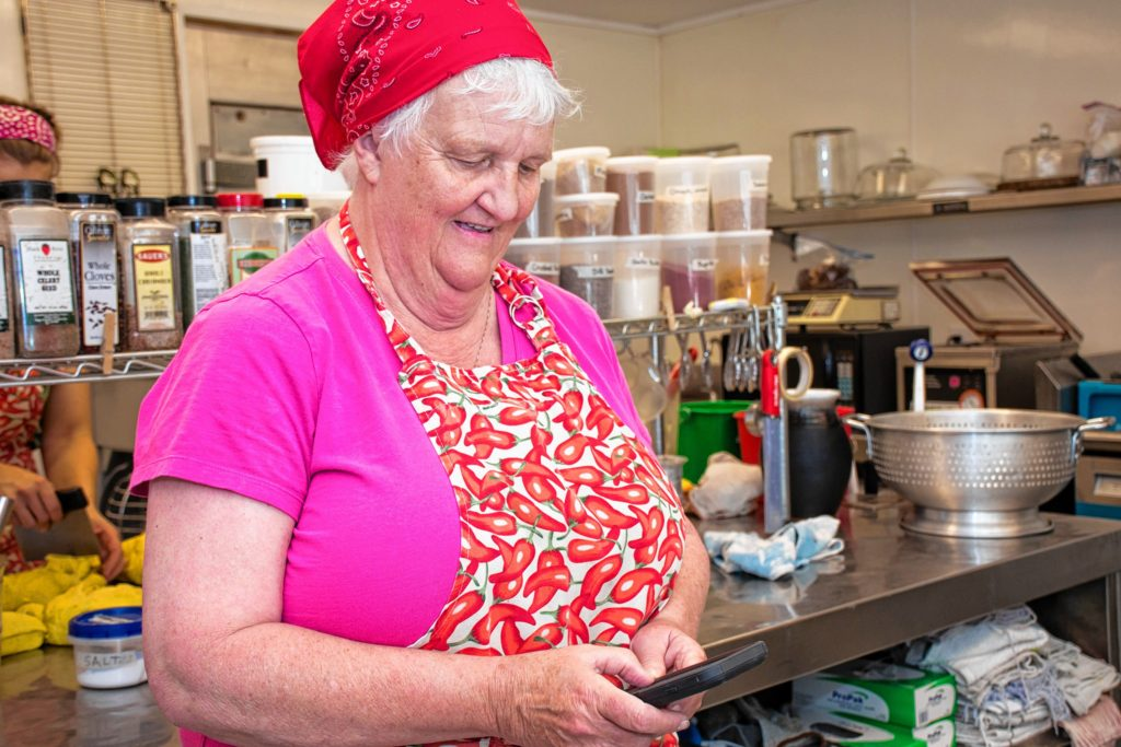 Milde Waterfall from Reading Vt. searches on her phone for a substitute for Dijon mustard for a homemade dressing she was making. In the end she went to the store buy a bottle of Dijon. Nancy Nutile-McMenemy photograph.