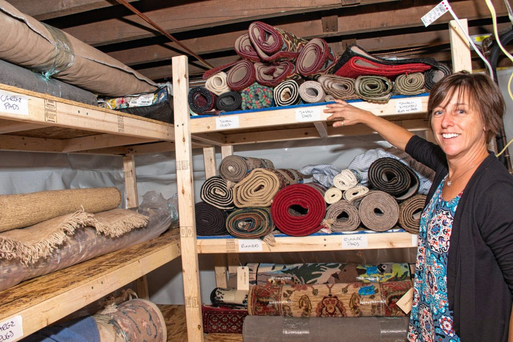 Sarah Dole, owner of Easy Peasy Organizing, shows the rug storage system she created for homeowner Eileen O'Connor. Nancy Nutile-McMenemy photograph.