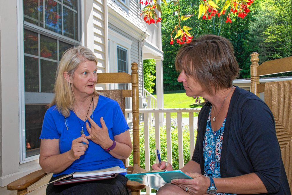 Eileen O'Connor, left, of West Lebanon, N.H., meets with Sarah Dole of Easy Peasy Organizing, right, to set goals and time frames for transitioning O'Connor's home and yard from winter to summer. Nancy Nutile-McMenemy photograph.
