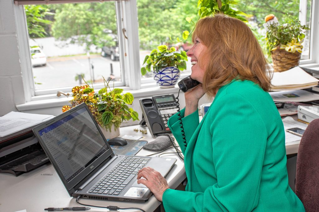 On the phone and on the computer is no problem for Tracy Hutchins, the new executive director of the Hanover Area Chamber of Commerce. She started May 1. Nancy Nutile-McMenemy photograph.