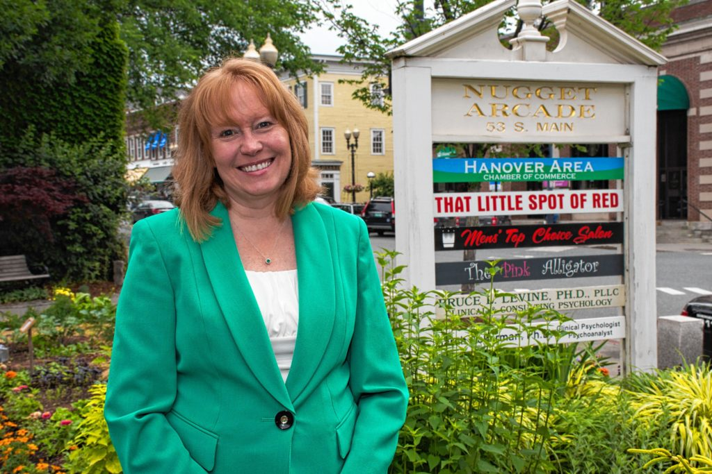 The Hanover Area Chamber of Commerce is located in the Nugget Arcade in downtown Hanover. The new executive director, Tracy Hutchins stand in front of the building's sign. Nancy Nutile-McMenemy photograph.