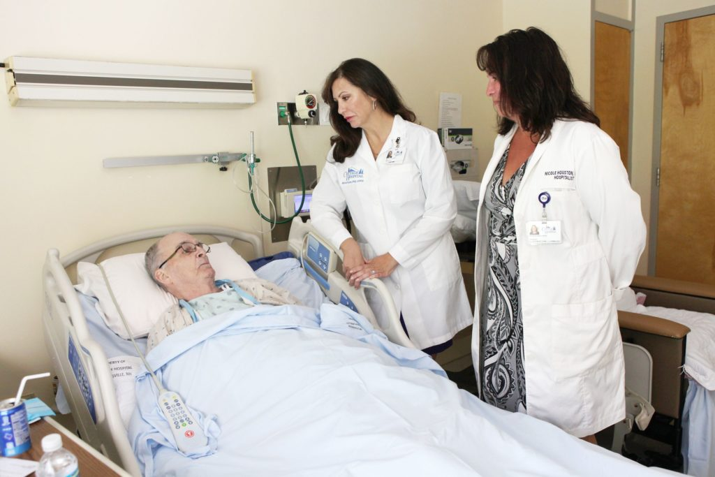 Cottage Hospital CEO Maria Ryan, center, and nurse practitioner Nicole Houston, right, visit with patient Tim Douse, of East Ryegate, Vt., on Wednesday, June 14, 2017, in Woodsville, N.H. (Valley News - Jovelle Tamayo) Copyright Valley News. May not be reprinted or used online without permission. Send requests to permission@vnews.com.
